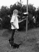 Image of girl using poo bag dispanser, Photo by Alison Bride