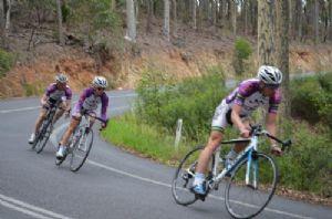 Bike riders on road.