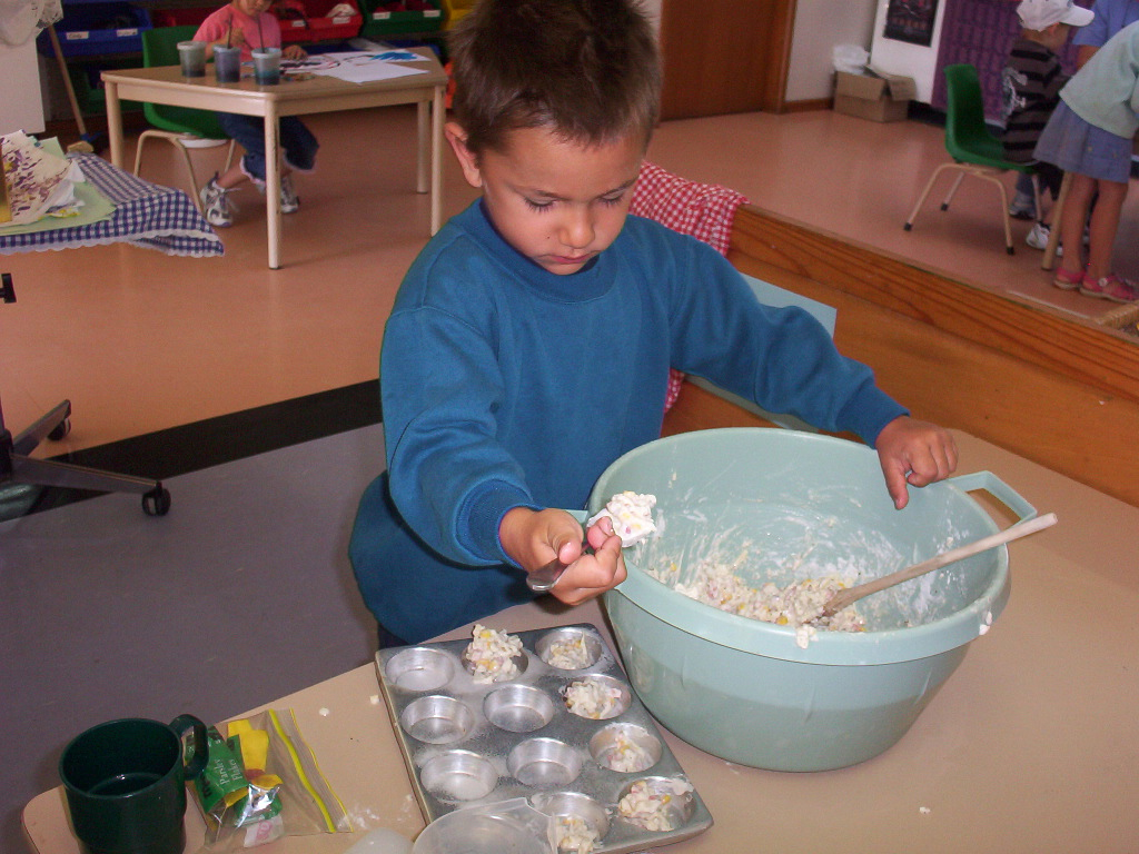Image of a child cooking.
