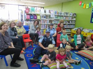 Some parents and grandparents were on hand when Officer Karen Nelligan and Sarah Bancroft read to pre-schoolers in the Bega Library on Thursday. The children are Billie Finnegan, Cormac Ryan, Judd Mackey, Arlo, Riley, Isla Sweeny and Juniper.