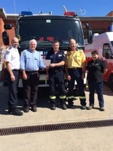 The Rural Fire Service�s Martin Webster and Garry Cooper (far left and second from right) and Rick Dawson (centre) from Fire and Rescue NSW with Council�s Greg O�Donnell and Amanda McKenna.