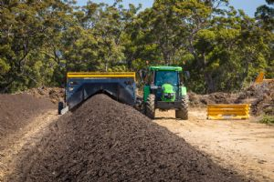 Compost windrows being turned at Merimbula waste depot