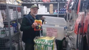 Owner of Southern Farm Supplies, Steve Ireland, checks the contents of the spill response kit
