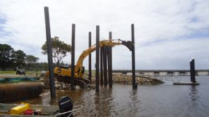 Steel piles being positioned prior to being driven into the river bed to provide footings for the new boat ramp.