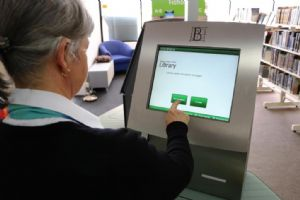 The library�s self-check machine in use.