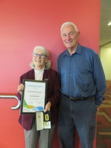 Gae Rheinberger is congratulated by her husband John on receiving her Bega Valley Shire Medallion this week.