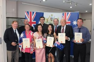 (Back row, from left) Mayor Michael Britten with Lawrence Verney, Tamer Ahmed, Member for Eden Monaro Peter Hendy, Chris Smeda, Wayne Armstrong and (front) Pauline Rees, Sommai Harris and  Supichaiya Luanmongkol at a citizenship ceremony in Bega this week.