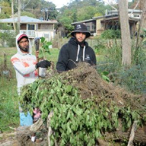 Rip Harrison and Joe Stewart of the Eden Local Aboriginal Land Council work crew dealing with crofton weed at Pambula Beach.