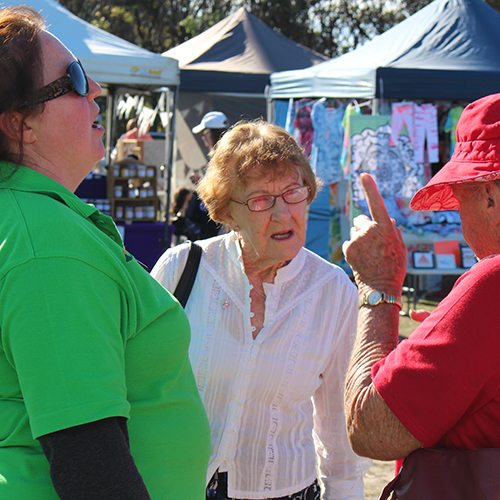 Council�s Loretto Mills speaking with community members at the Merimbula Rotary Markets.