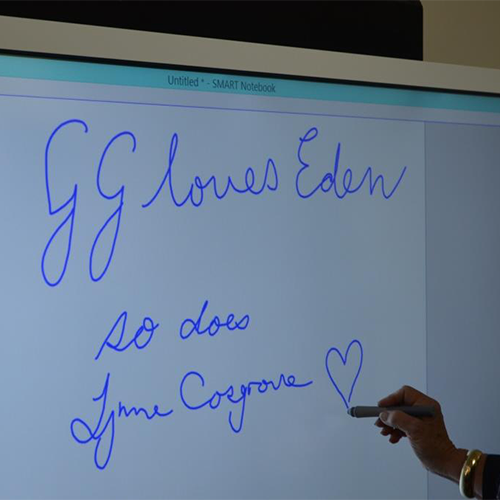 Governor General, Sir Peter Cosgrove, with Lady Cosgrove and children and staff from Eden Childcare Centre. Also, the message written on the classroom smartboard.