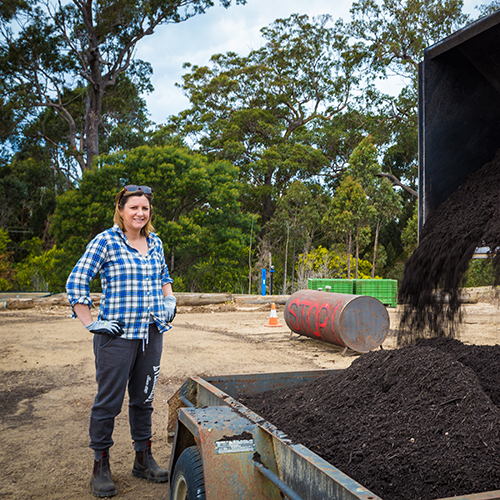 Mayor Cr Kristy McBain picks up a load of compost from the Merimbula organics processing facility for her garden.