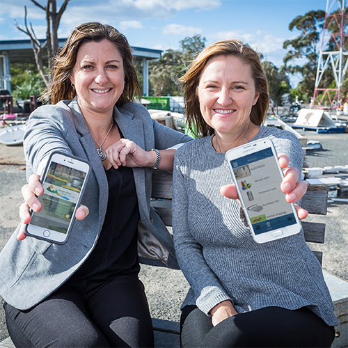 Mayor Kristy McBain and Joley Vidau using the Bega Valley Waste App.
